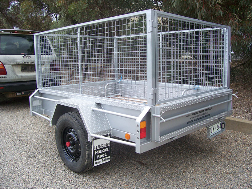 photo of grey trailer with cage
